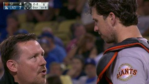 SF@LAD: Posey hit on mask by foul ball, stays in game