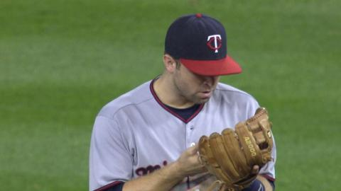 Dozier has words with his glove after the DP