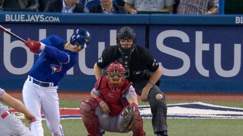 CIN@TOR: Umpire hit by foul ball, stays in game