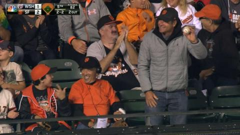 Fan makes a nice grab on a foul ball