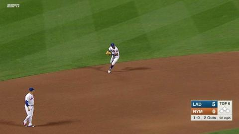 LAD@NYM: Rosario makes a great running throw for out