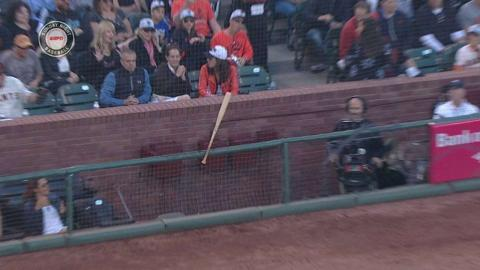 LAD@SF: Posey loses grip, bat gets stuck in netting