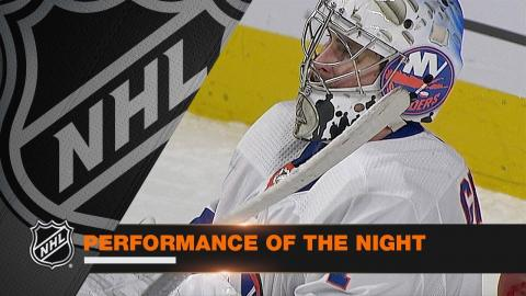 Greiss turns away 52 shots in Isles' OT win