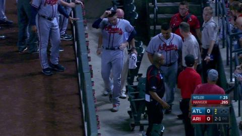 ATL@ARI: Freeman tumbles over railing, stays in game