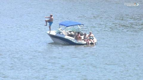 PHI@CIN: A fan jumps off his boat in Ohio River
