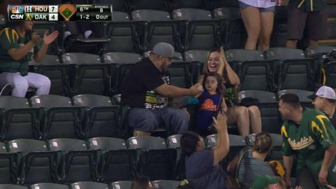 HOU@OAK: Dad catches foul ball, gives it to daughter
