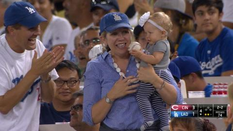 CIN@LAD: Fan with baby ends up with foul ball