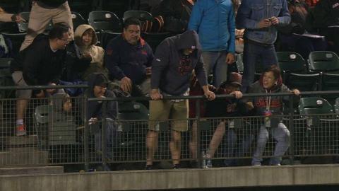 COL@SF: Fan misses foul ball, hears it from friends