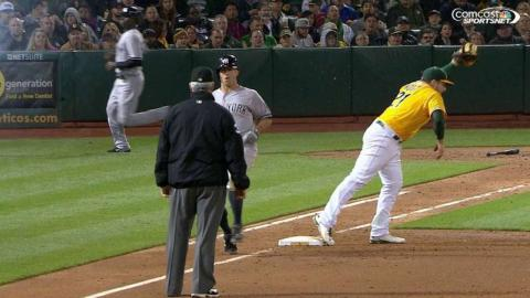 NYY@OAK: Vogt digs out Semien's throw to first