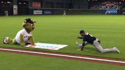 Houston Astros mascot Orbit tries to play Twister with the A's