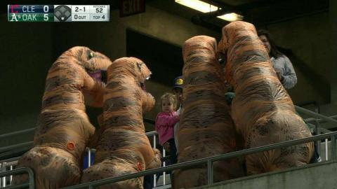 Dinosaurs pose for pics at Athletics game
