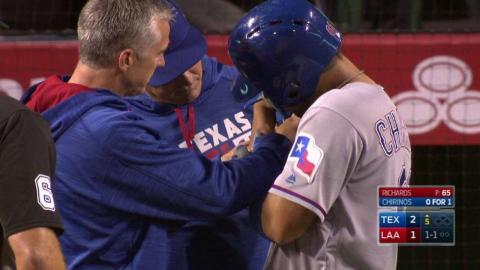 TEX@LAA: Chrinos gets hit on his swing, leaves game
