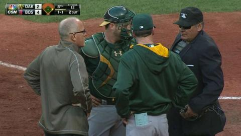 OAK@BOS: Vogt shaken up on a wild pitch, remains in