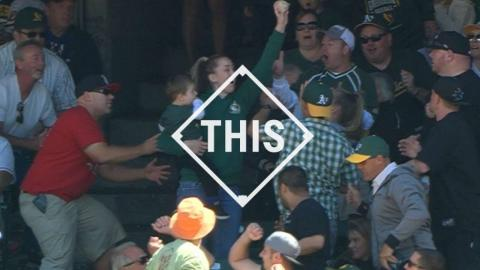 #THIS: Mom catches foul ball with child in tow