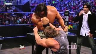 Triple H Vs. The Great Khali (Broken Glass Arm Wrestling Contest)